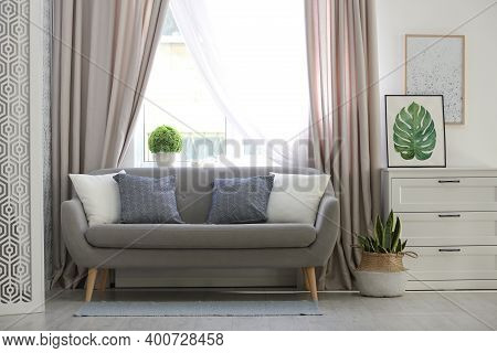 Beautiful Curtains On Window In Stylish Living Room Interior