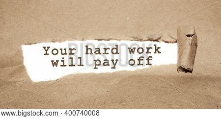 The Text Your Hard Work Will Pay Off Appearing Behind Torn Brown Paper. Business Startup Devepolment