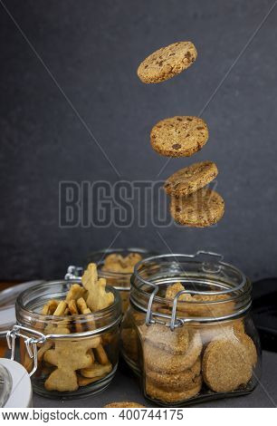 Cookies With Almond Crumbs And Cookies With Lingonberries. Round Homemade Cookies Flies In A Jar. Le