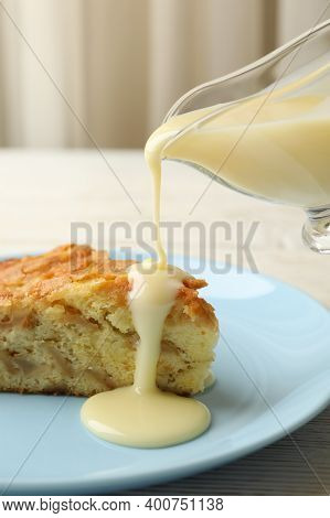Condensed Milk Is Poured From The Gravy Boat On Pie, Close Up