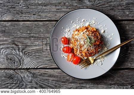 A Portion Of Ground Beef Risotto Bolognese Sprinkled With Grated Parmesan Cheese On A Plate, Italian