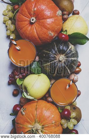 Pumpkin Juice, Autumn Harvest Of Vegetables, Fruits And Nuts, Thanksgiving Concept, Top View And Ton