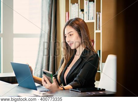 Asian Business Woman Using Smartphone At Home
