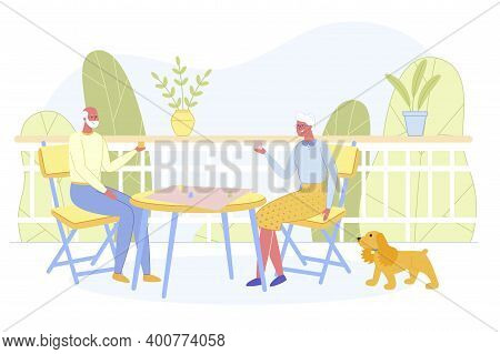 Relaxing Senior Man And Woman Playing Board Game At Home. Couple Cheerful Pensioners Spending Time T