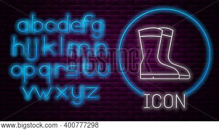 Glowing Neon Line Fishing Boots Icon Isolated On Brick Wall Background. Waterproof Rubber Boot. Gumb