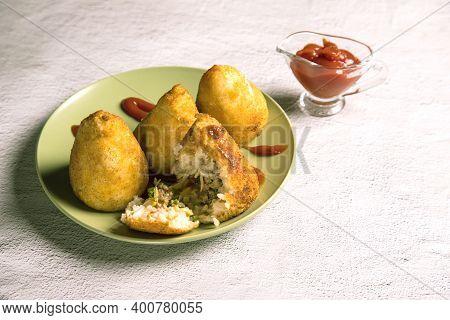 Sicilian Dish Arancini-fried Rice Balls. Italian Cuisine. Copy Space. Horizontal Orientation