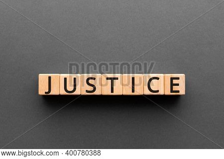 Justice - Word From Wooden Blocks With Letters, A Judge Or Magistrate Justice Concept, Black Backgro