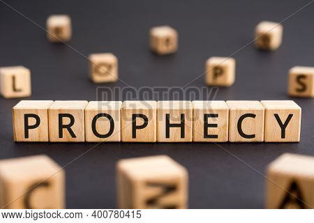 Prophecy - Word From Wooden Blocks With Letters, A Prediction Prophecy Concept, Random Letters Aroun