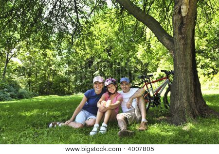 Family Resting In A Park