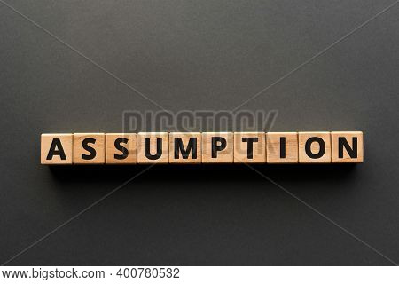 Assumption - Words From Wooden Blocks With Letters, No Proof  Accept As True Assumption Concept, Top