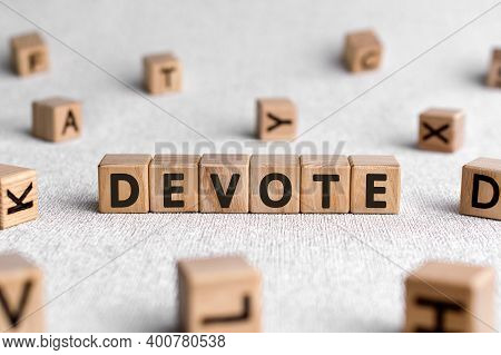 Devote - Words From Wooden Blocks With Letters, To Give All Of Something Devote Concept, White Backg