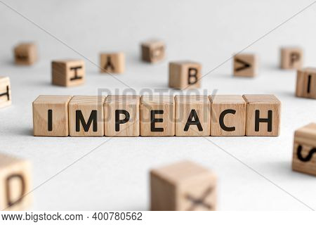 Impeach - Words From Wooden Blocks With Letters, To Charge With A Crime Impeach Concept, White Backg