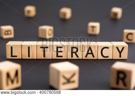 Literacy - Word From Wooden Blocks With Letters, Literacy The Ability To Read And Write Concept, Ran