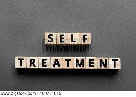Self Treatment - Words From Wooden Blocks With Letters, Self-administer Treatment Concept, Top View