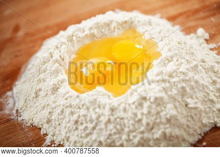 Flour And Eggs As Ingredients For Making Pasta Dough.