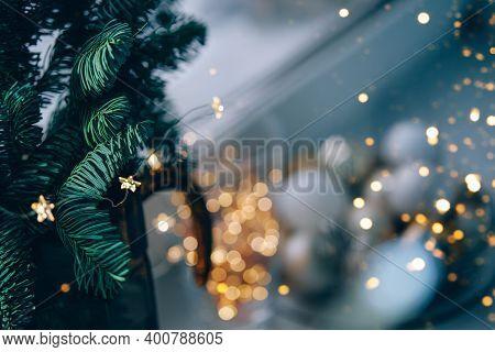 Christmas Decoration On Windowsill.fir Tree Branch And Fairy Lights.