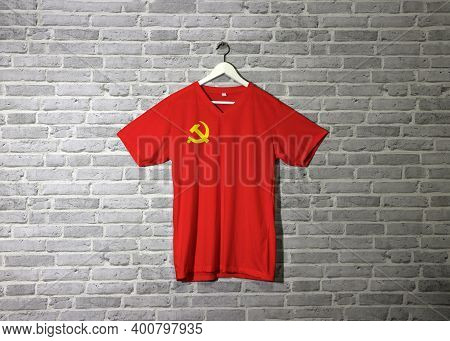 Chinese Communist Party Flag On Shirt And Hanging On The Wall With Brick Pattern Wallpaper, Golden H