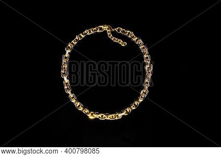 Golden Jewelry Chain Isolated On Black Background