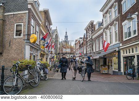Gouda, Netherlands, November 2018 - Women Walking In The Street In The City Of Gouda, Netherlands