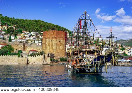 Alanya, Turkey - October 22, 2020: Pirate Ship For Parties Baba Boat On The Background Of The Red To