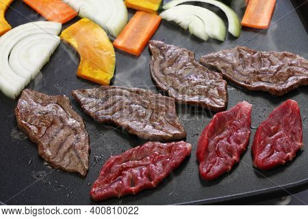grilled meat by electric griddle, a rare part of japanese wagyu beef called Senbon