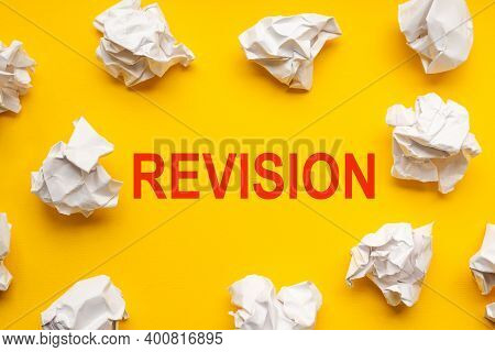 Revision Text On Yellow Background With Copy Space. Crumpled Sheets Of Paper Lie Around. Business Co