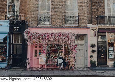 London, Uk - December 5, 2020: Pastel Pink Decorated Facade Of Saint Aymes Cafe In Mayfair, An Afflu