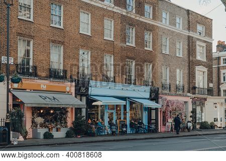 London, Uk - December 5, 2020: Row Of Cafes And Florist Decorated For Christmas On Connaught Street