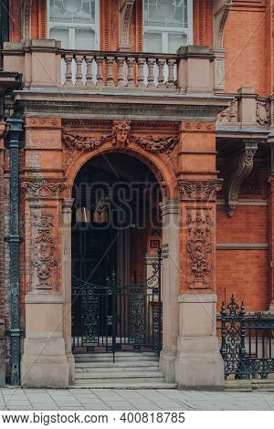 London, Uk - December 5, 2020: Entrance Of A Traditional Red Brick Apartment Block In Mayfair, An Af