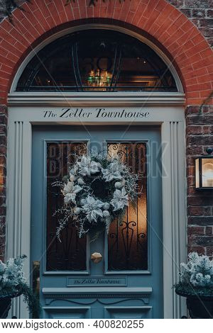 London, Uk - December 5, 2020: Christmas Wreath Decoration On The Front Door Of The Zetter Townhouse