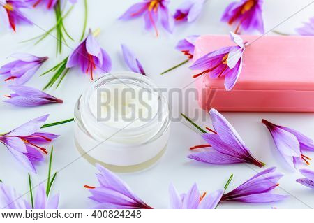 Saffron Flowers, Cosmetic Cream And Saffron Soap On A White Background. Cream With Saffron Extracts.