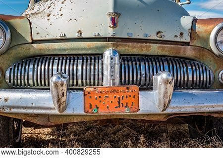 Swift Current, Sk- April 20, 2020: Abandoned 1950s Green Mercury Eight Sedan On The Prairies In Sask