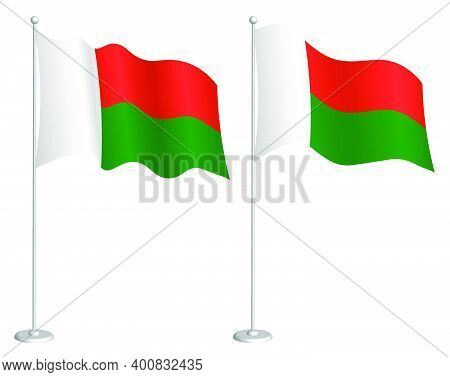 Flag Of Madagascar On Flagpole Waving In Wind. Holiday Design Element. Checkpoint For Map Symbols. I