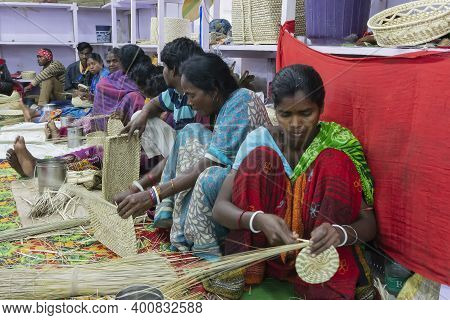 Kolkata, West Bengal, India - 31st December 2018 : Young Bengali Women Making Wicker Baskets For Sal