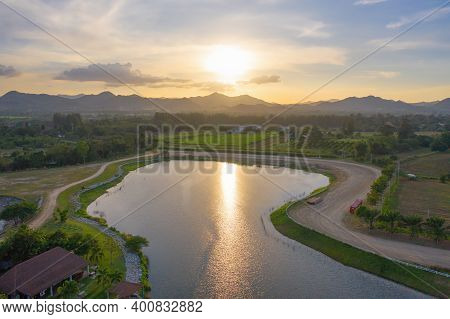 Aerial View Of Green Mountain Hill With Lake Or River. Nature Landscape Background In Khao Yai, Nakh
