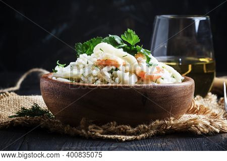 Risotto With Shrimp And Squid In A Wooden Bowl, Dark Background, Selective Focus
