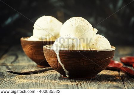 Vanilla Ice Cream Balls, Brown Bowls, Dark Background, Selective Focus