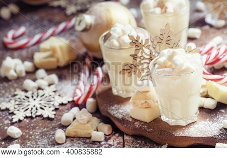 Hot White Chocolate With Marshmallows In A Xmas Decoration With Snowflakes, Pine Cones And Christmas