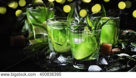 Alcoholic Green Cocktail With Lime, Lemon Juice, Cane Sugar, Soda, Crushed Ice And Tarragon Leaves,