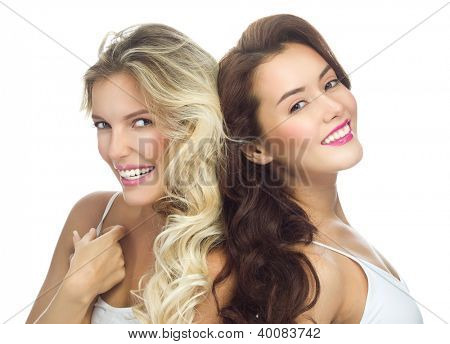 portrait of two attractive  caucasian smiling women blond isolated on white studio shot  toothy smile face long hair head and shoulders looking at camera