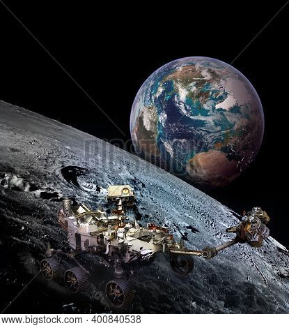Moon Rover On Moon Surface And Planet Earth Rising. Elements Of This Image Furnished By Nasa.