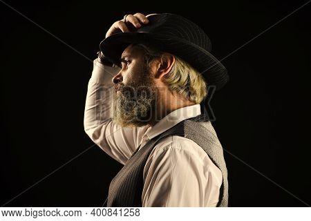 Past Centuries Trend. Bearded Guy Black Background. Beard Grooming. Retro Gentlemen. Mature Handsome