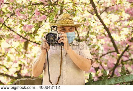 Pollen Allergy. Tourist Camera Photo. Nature Photography. Senior Man Respirator Mask. Professional P