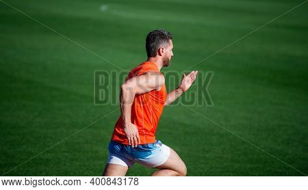 Towards The Healthier Lifestyle. Runner Run On Running Track. Energetic And Sporty. Marathon Speed E