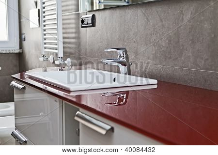 Red Bathroom Faucet Reflection