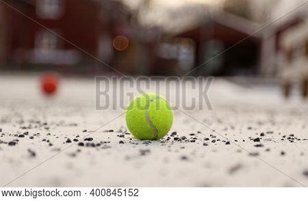 A Tennis Ball Lying On An Abandoned Schoolyard