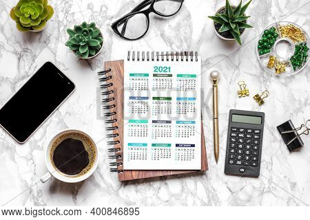 Open Calendar 2021, Glasses, Cup Of Coffee, Pen, Smartphone, Succulents On Marble Table Top View Fla