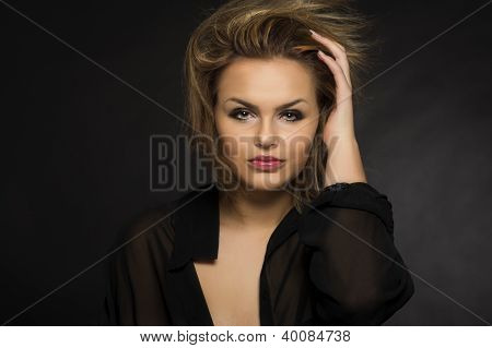 Beautiful Woman With A Windblown Hairstyle