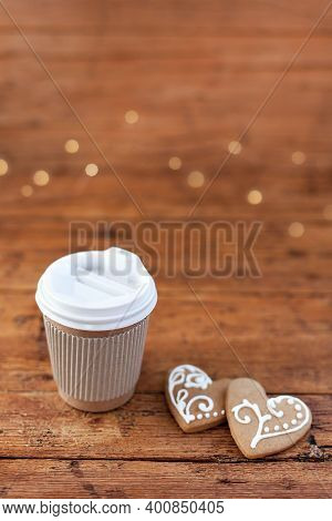 Christmas Coffee Takeout. Cup Of Cocoa And Gingerbread Cookies At Wooden Background With Lights. Hom