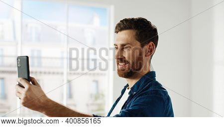 Close Up Of Happy Handsome Young Caucasian Male Taking Selfie Photos On Smartphone Giving Thumb Up R